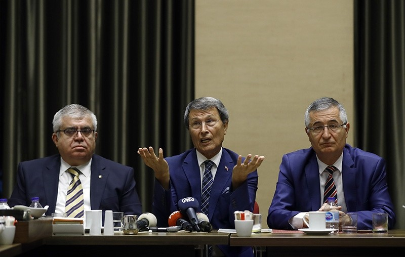Good Party (IP) founders Yusuf Halau00e7ou011flu (C), u00d6zcan Yeniu00e7eri (R) ve Nevzat Bor (L) resign from their positions during press conference on Aug. 6, 2018. (AA Photo)