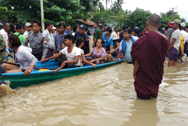 People are evacuated after flooding in Swar township, Myanmar, August 29, 2018. (Reuters Photo)