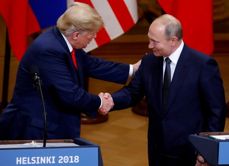 US President Donald Trump, left, and Russian President Vladimir Putin shake hands as they hold a joint news conference after their meeting in Helsinki, Finland, July 16, 2018. (Reuters Photo)
