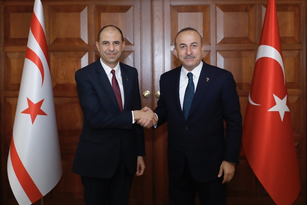 Turkish Foreign Minister Mevlu00fct u00c7avuu015fou011flu with Turkish Republic of Northern Cyprus Foreign Minister Kudret u00d6zersay, (L), in Ankara, yesterday.