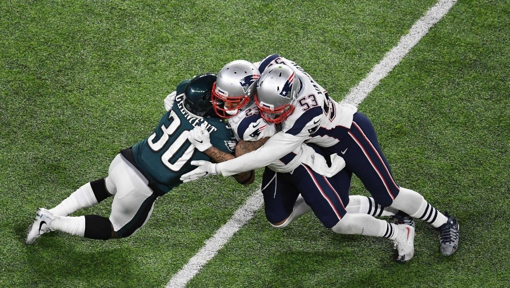 Corey Clement (30) of the Eagles collides with Patrick Chung (23) and Kyle Van Noy (53) of the Patriots during Super Bowl LII between the New England Patriots and the Philadelphia Eagles at U.S. Bank Stadium in Minneapolis.