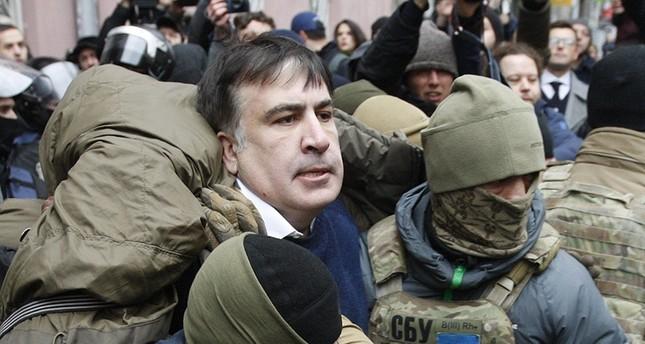 Ukrainian Security Service officers detain Mikheil Saakashvili at the entrance of his house in Kiev, Ukraine, Dec. 5, 2017. (AA Photo)