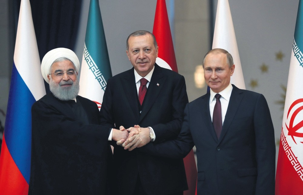 Presidents Rouhani of Iran (L), Erdou011fan (C) and Putin of Russia pose before meeting on the Syrian crisis, Ankara, April 4.