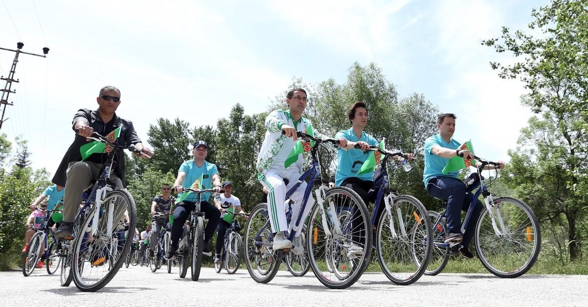 Cyclists tour around Eymir Lake, June 3, 2019.