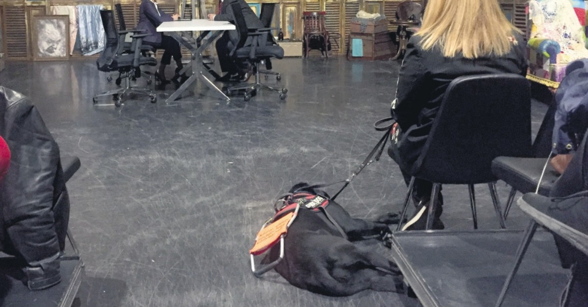 Nurdeniz Tuu00e7er watches the rehearsals of an Istanbul State Theaters' play with her guide dog Kara.