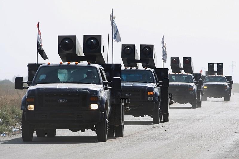 Iraqi forces drive towards Kurdish peshmerga positions Oct. 14, 2017, on the southern outskirts of Kirkuk, Iraq. (AFP Photo)