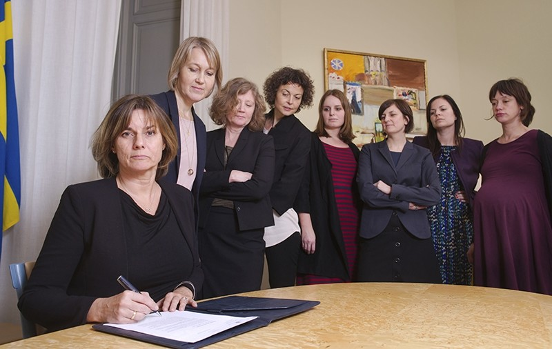 In this handout photo provided by the Swedish Gov't, Sweden's Deputy PM Isabella Lovin(L) signs a proposal for a new climate law, Feb. 3, 2017. (AP Photo)