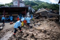 Japan flood toll hits 156 as rescuers go house to house