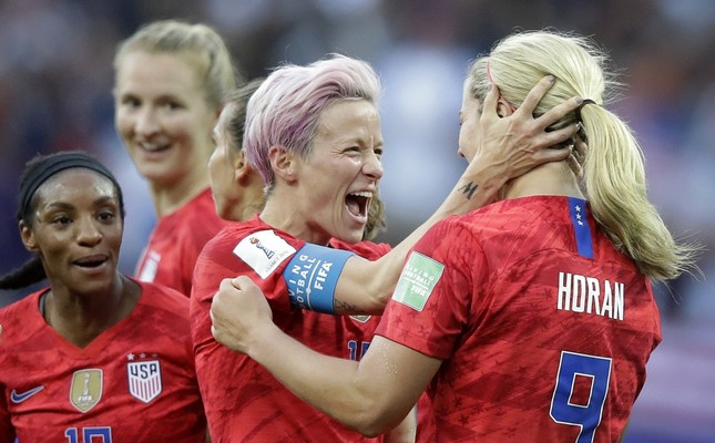 United States' scorer Lindsey Horan (R), celebrates their side's 3rd goal with Megan Rapinoe, June 11, 2019.