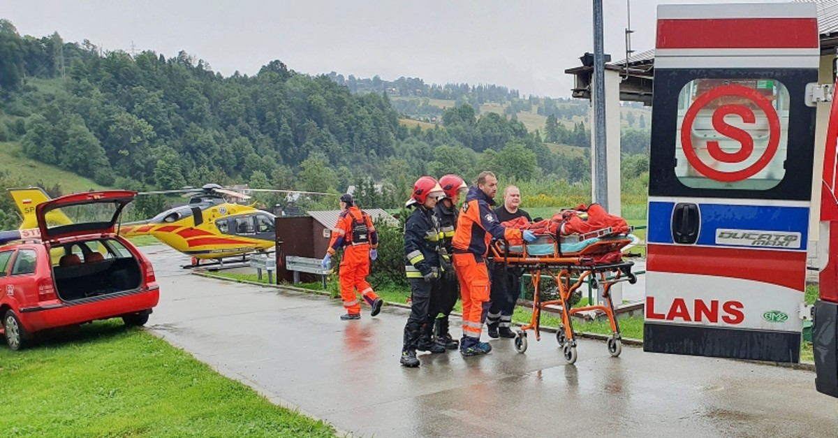 Rescue helicopter and ambulance have brought to hospital the first people injured by a lighting strike that struck in Poland's southern Tatra Mountains during a sudden thunderstorm, in Zakopane, Poland, on Thursday, Aug. 22, 2019. (AP Photo)