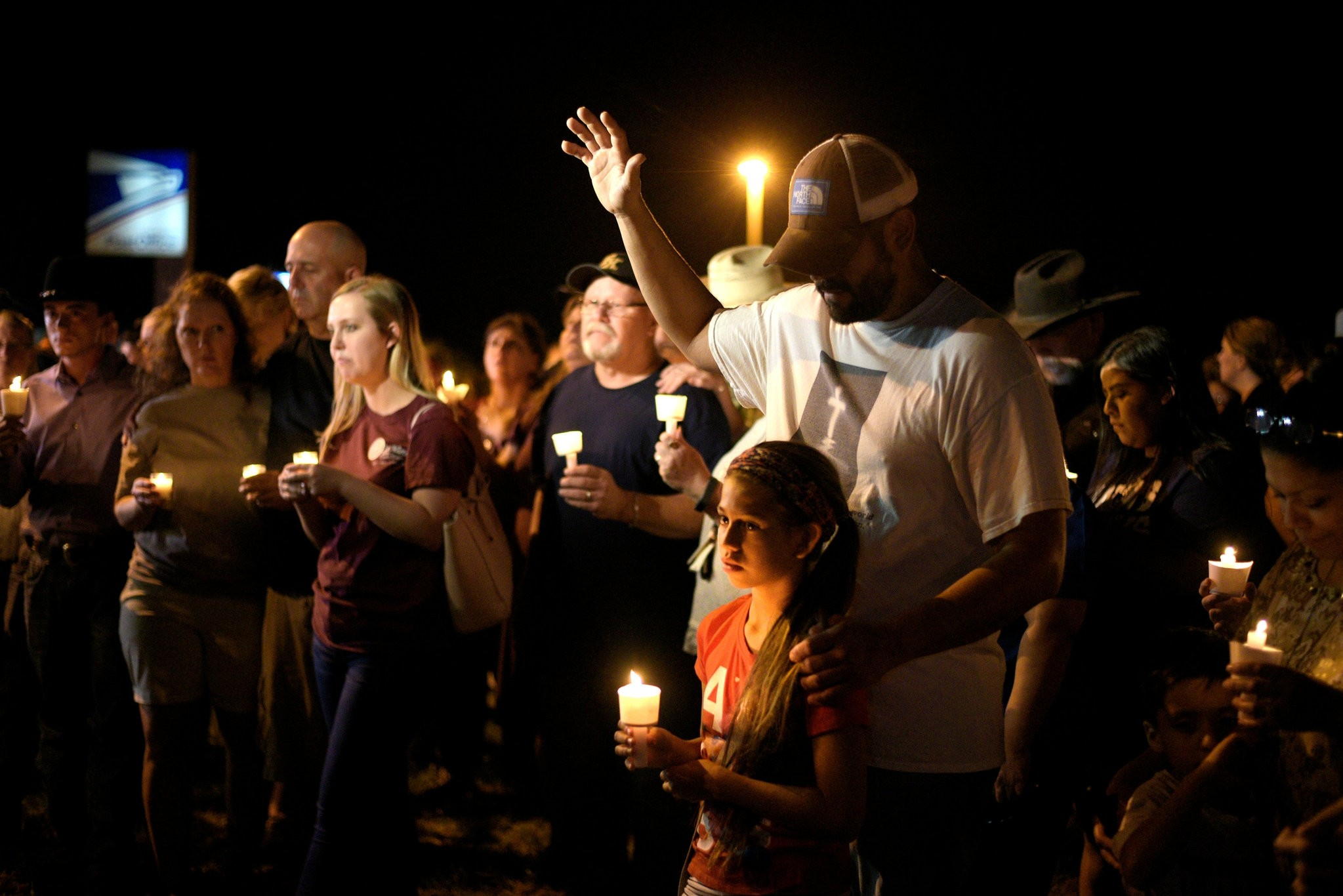 People attend a candle light vigil after a mass shooting at the First Baptist Church in Sutherland Springs, Texas, Nov. 5.
