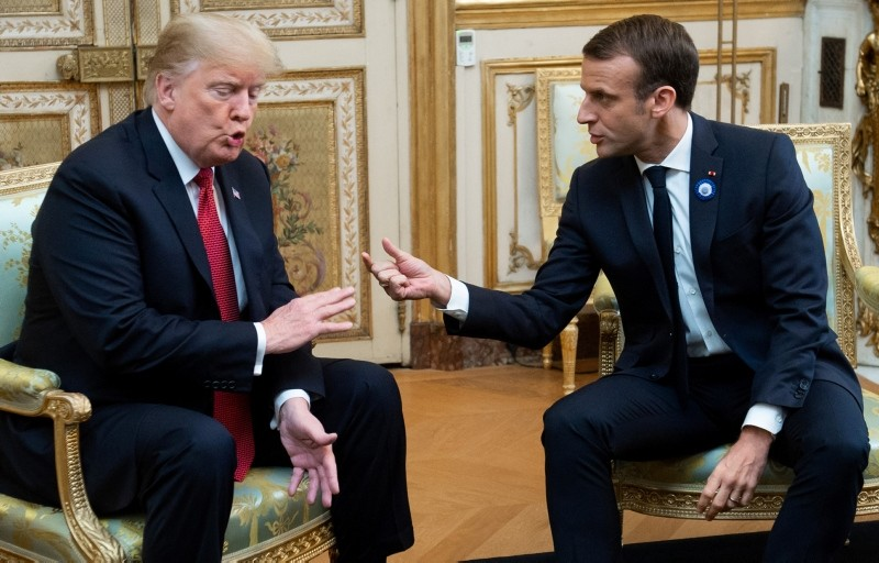 In this file photo taken on Nov. 10, 2018 US President Donald Trump (L) speaks with French president Emmanuel Macron prior to their meeting at the Elysee Palace in Paris. (AFP Photo)