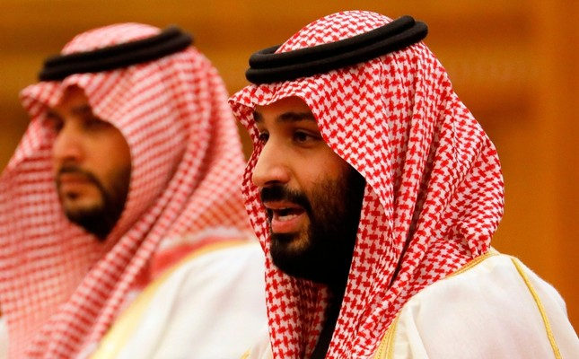 Saudi Crown Prince Mohammed bin Salman R attends a meeting with Chinese President Xi Jinping not pictured at the Great Hall of the People in Beijing on February 22, 2019. AFP Photo