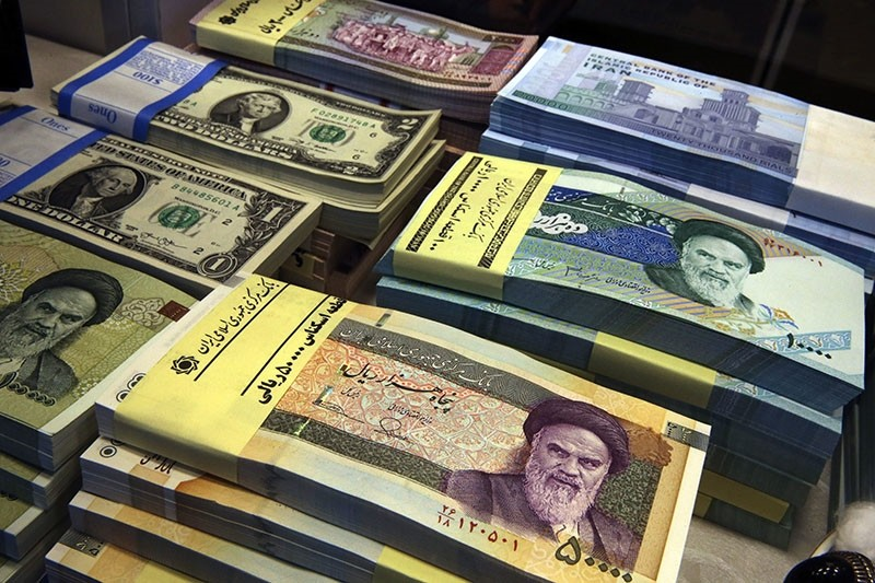 In this April 4, 2015 photo, Iranian and U.S. banknotes are on display at a currency exchange shop in downtown Tehran, Iran. (AP Photo)