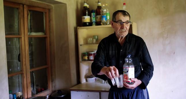 Temur Batirashvili, father of Tarkhan Batirashvili, speaks during an interview at his home in the village of Birkiani in the Pankisi Gorge, Georgia, May 19, 2016. (REUTERS Photo)