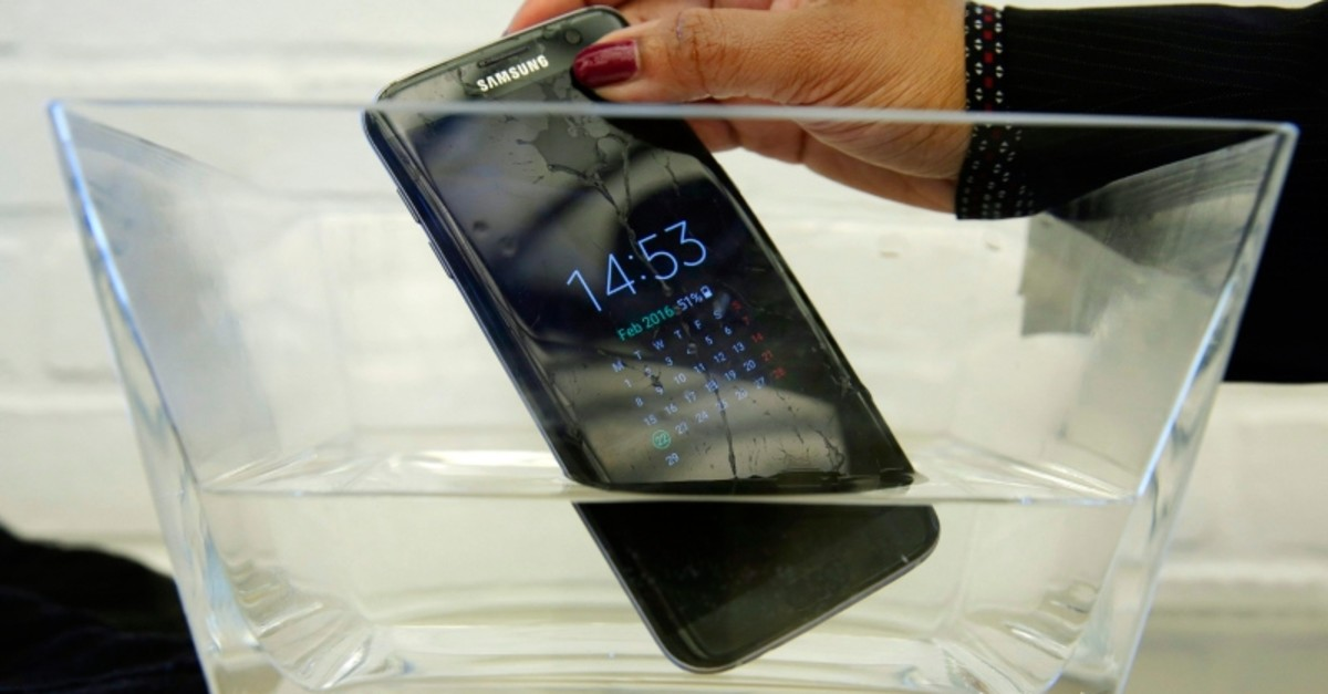 In this Feb. 22, 2016, file photo, a waterproof Samsung Galaxy S7 Edge mobile phone is submersed in water during a preview of Samsung's flagship store, Samsung 837, in New York's Meatpacking District. (AP Photo)