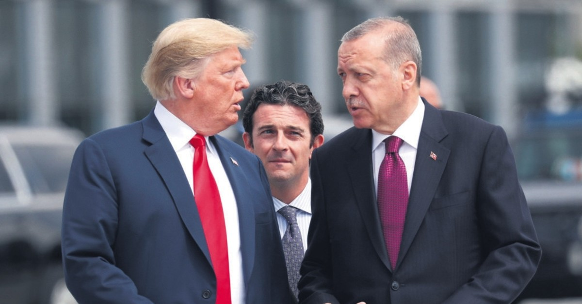 President Recep Tayyip Erdou011fan and U.S. President Donald Trump (L) gesture as they talk at the start of the NATO summit, Brussels, Belgium, July 11, 2018.
