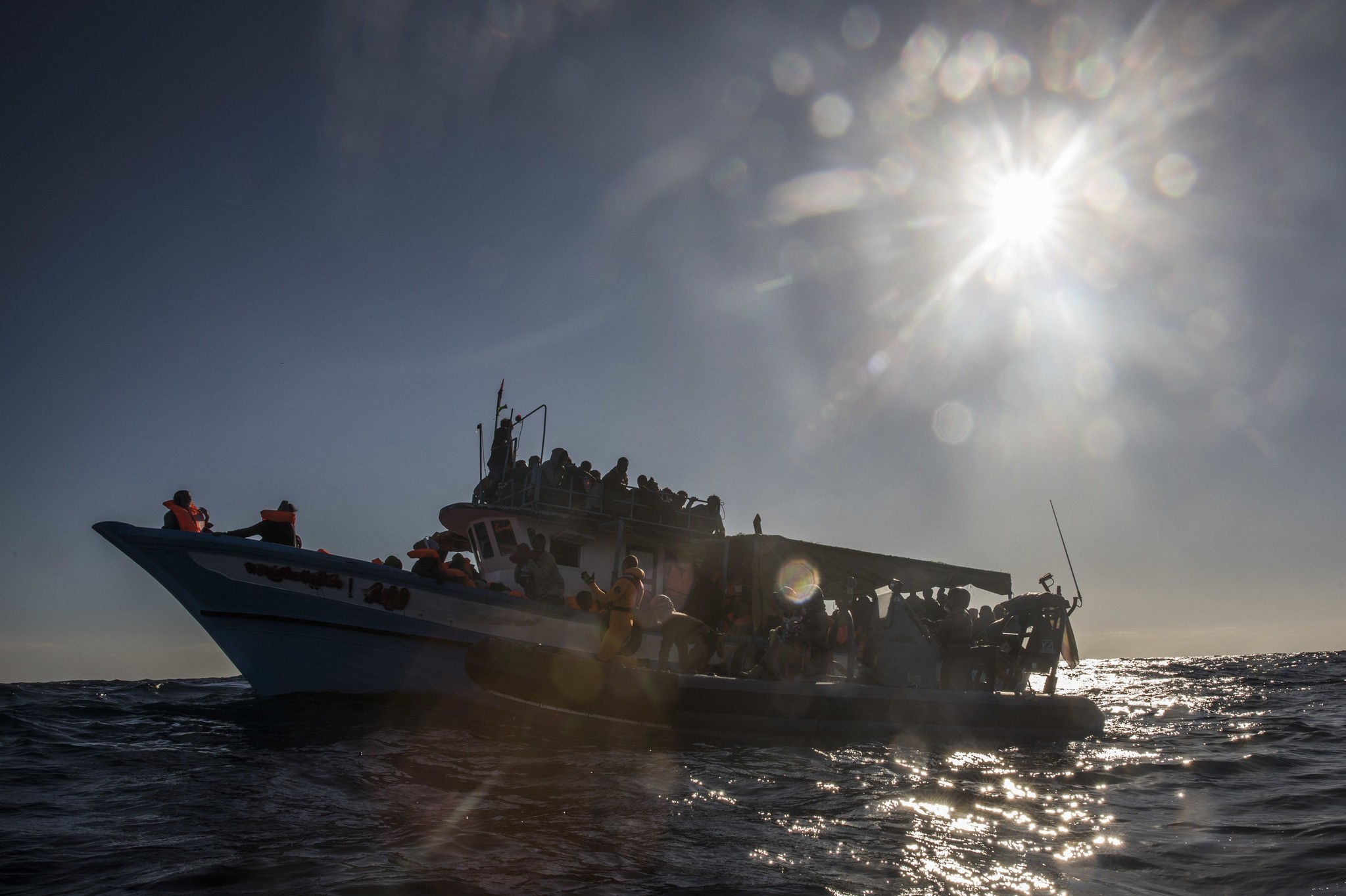 In this Saturday Jan. 27, 2018, photo shows 329 refugees and migrants trying to reach European soil aboard an overcrowded wooden boat, 45 miles north of Al-Khums, Libya. (AP Photo)