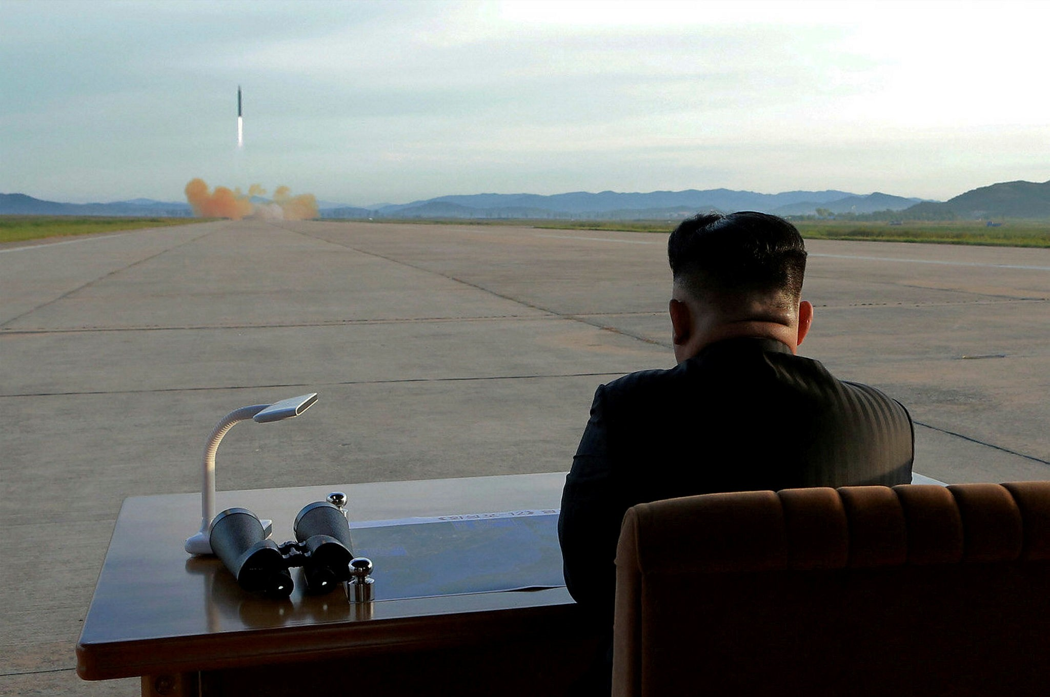 North Korean leader Kim Jong Un watches the launch of a Hwasong-12 missile in this undated photo released by North Korea's Korean Central News Agency (KCNA) on September 16, 2017. (Reuters Photo)