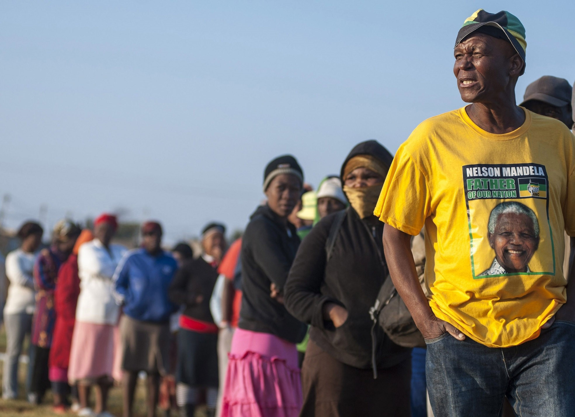 A supporter of the African National Congress (ANC) wears a t-shirt depicting late South African president Nelson Mandela.