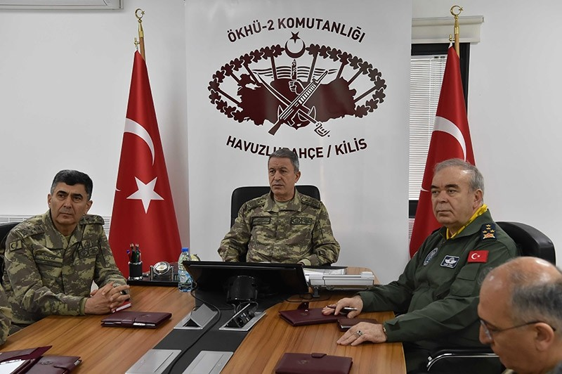 Turkish Chief of Staff General Hulusi Akar (center) is seen in a meeting in Kilis, southeastern Turkey, during his visit to troops stationed at the Syrian border. Feb. 5, 2017.