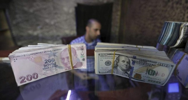 Banknotes of U.S. dollars and Turkish lira in a currency exchange shop in Azaz, Syria, Aug. 18, 2018. Reuters Photo