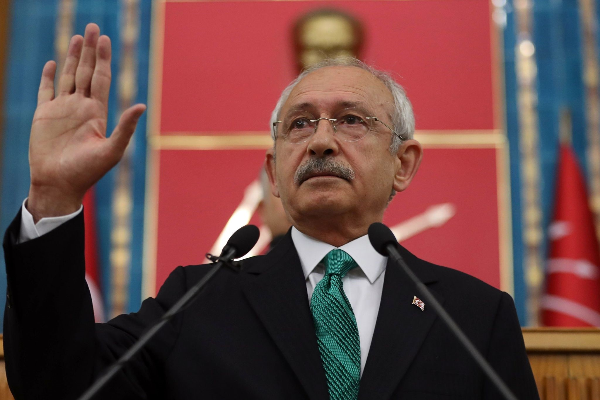 Kemal Ku0131lu0131u00e7darou011flu, leader of the CHP, gestures as he delivers a speech during a meeting at the Turkish parliament in Ankara, on April 18.