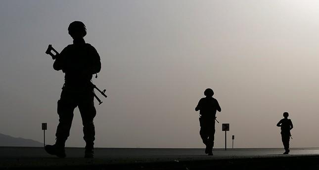Turkish soldiers patrol the road to Habur border gate near the Turkish-Iraq border in Silopi district (EPA Photo)