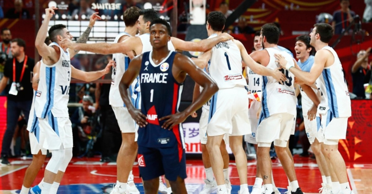 France's Frank Ntilikina looks dejected after the match as Argentina's players celebrate their victory in FIBA World Cup semifinals at Wukesong Sport Arena, Beijing, China, September 13, 2019. (Reuters Photo)