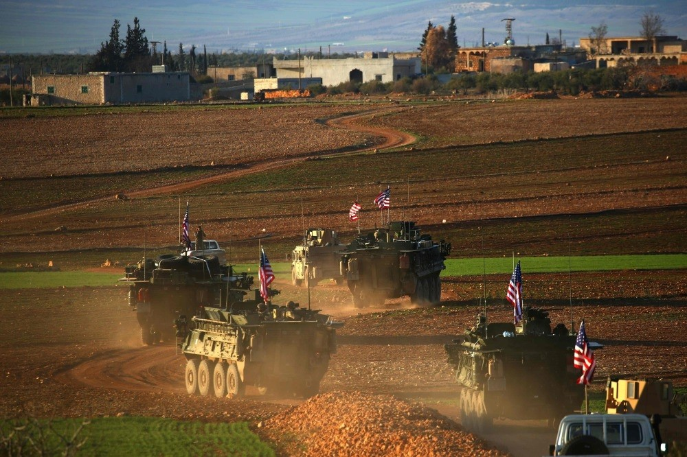 A convoy of U.S. forces' armored vehicles driving near the village of Yalanli, on the western outskirts of the north Syrian city of Manbij, March 5.