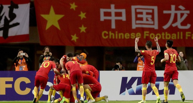 Chinese players celebrate after Yu Dabao scored during the World Cup football qualifying match against South Korea in Changsha, China's central Hunan province.