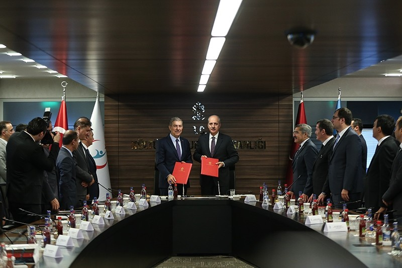 Minister of Health Ahmet Demircan (L) and Minister of Culture and Tourism Numan Kurtulmuu015f pose after signing the ,Protocol on Cooperation,, Ankara, Turkey, Oct. 18, 2017. (AA Photo)