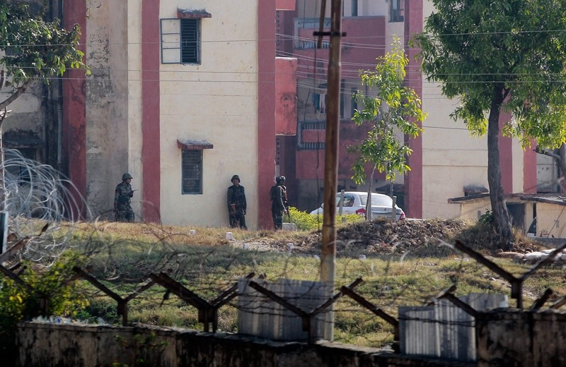Indian Army soldiers take positions outside the residential quarters located inside the Sunjwan Army camp in Jammu, India, Saturday, Feb. 10, 2018. (AP Photo)