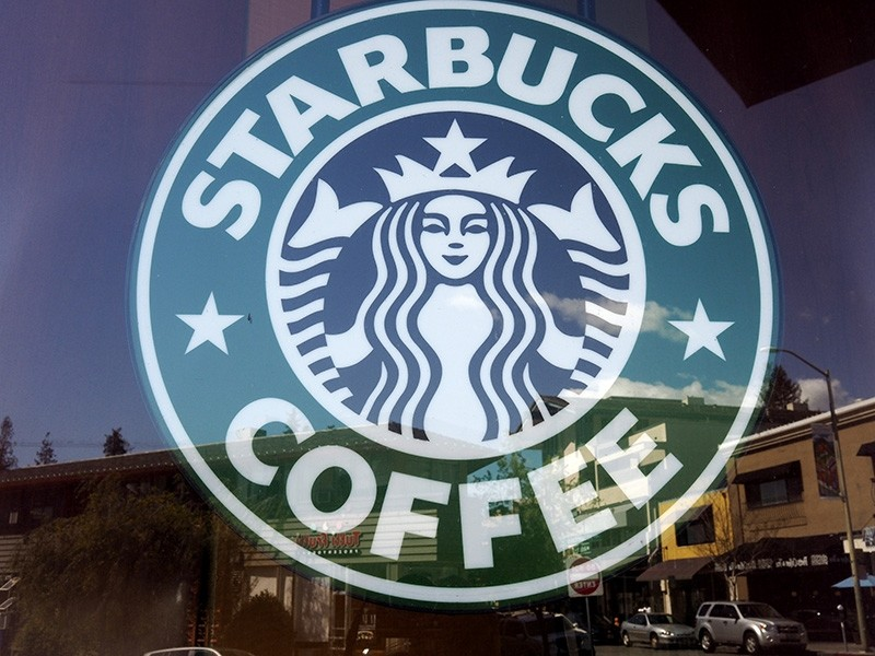 Starbucks signage in front of the store's window in Oakland, California, USA, 19 April 2018 (reissued 07 May 2018). (EPA Photo)