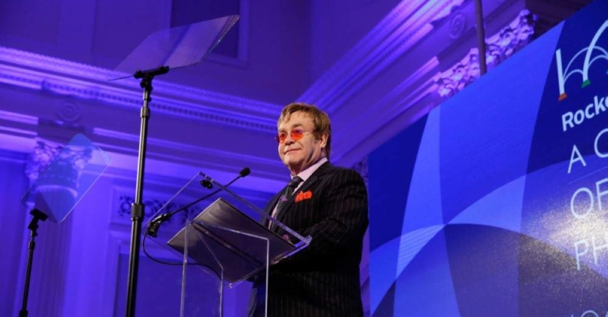 Elton John speaking after receiving a Lifetime Achievement Award from the Rockefeller Foundation, during an event at The Red Cross, Wednesday, Oct. 30, 2013 (AP Photo)