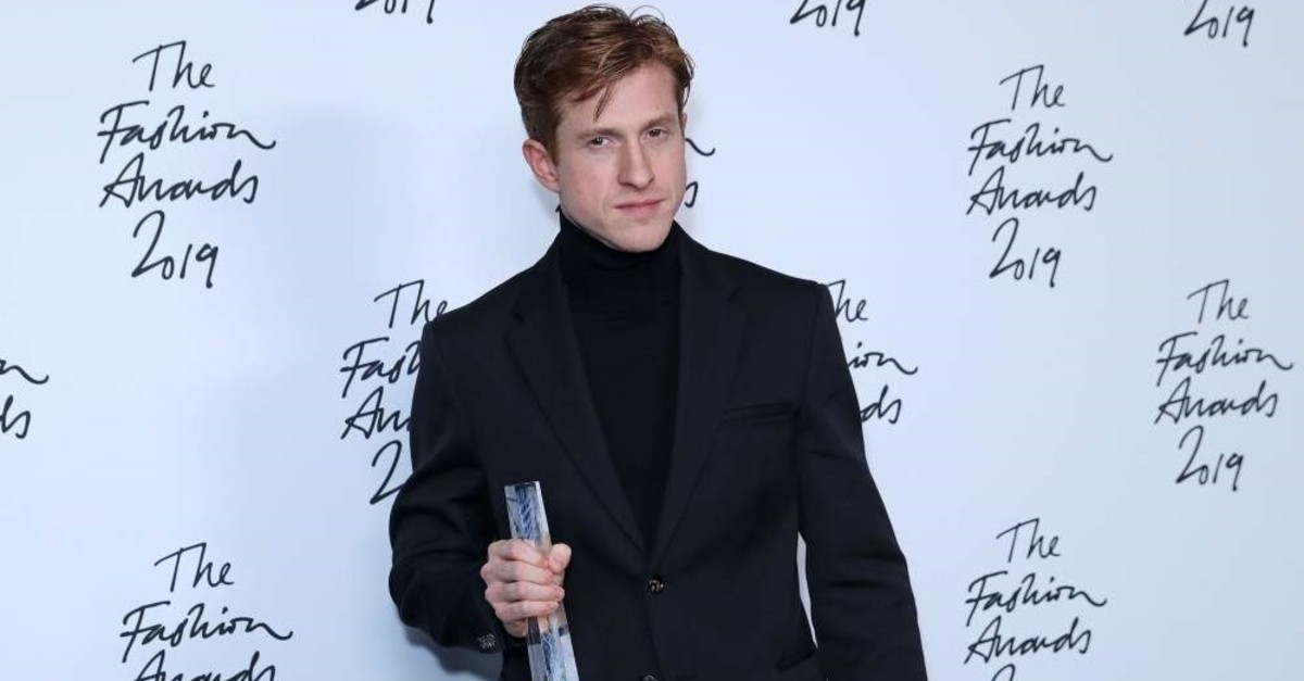 Bottega Veneta Creative Director Daniel Lee poses after the company won the Brand of the Year award at The Fashion Awards 2019 in London on Dec. 2, 2019. (AFP Photo)