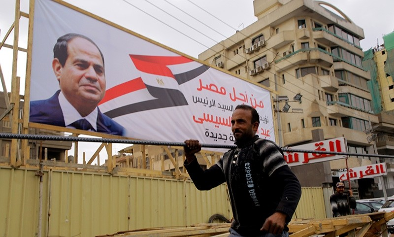 Egyptians laborers work at an under construction site near an election campaign poster erected by supporters of Egyptian President Abdel-Fattah el-Sissi, in Cairo, Egypt, Feb. 21, 2018. (EPA Photo)