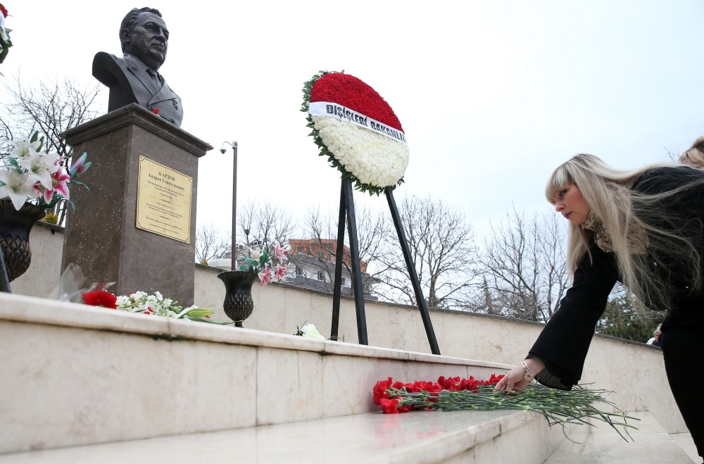 People lay flowers in front of a monument dedicated to Karlov at the Russian embassy in Ankara yesterday.