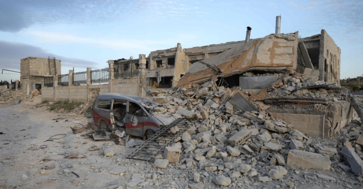 A picture taken on May 5, 2019 shows destruction at the entrance of a hospital in the village of Kafr Nabl, south of the Syrian province of Idlib. (AFP Photo)
