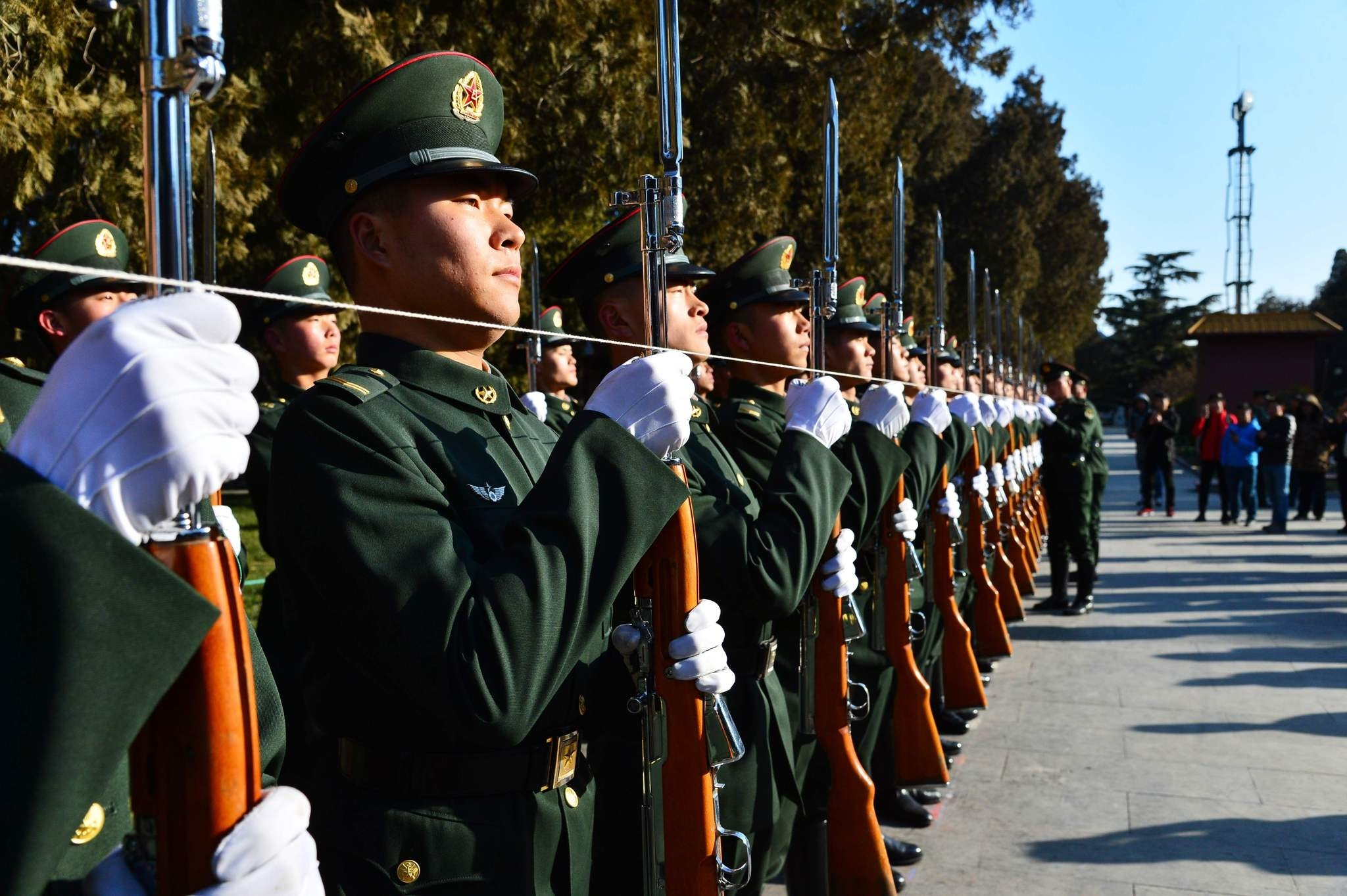 This photo taken on Jan. 1, 2018 shows members of the Chinese People's Liberation Army honour guard training at the Working People's Cultural Palace after the flag raising ceremony in Beijing. (AFP Photo)
