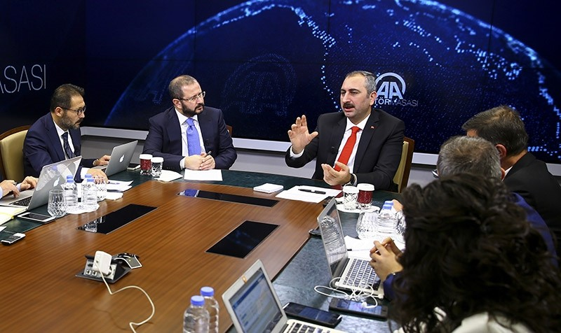 Justice Minister Abdulhamit Gu00fcl (center) speaking on Anadolu Agency's Editor's Desk on Oct. 19, 2017 (AA Photo)