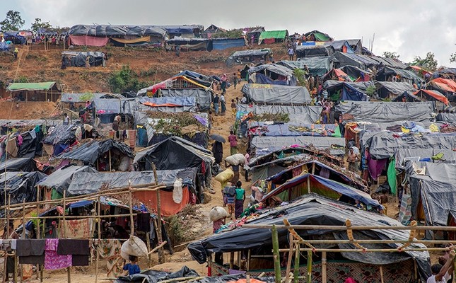 Newly set up tents cover a hillock at a refugee camp for Rohingya Muslims, who crossed over from Myanmar into Bangladesh, in Taiy Khali, Bangladesh, Sept. 22, 2017. AP Photo