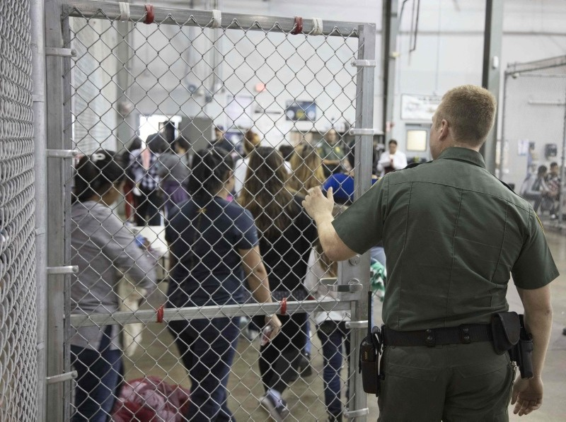 This US Customs and Border Protection photo dated June 17, 2018 and obtained June 18, 2018 shows intake of illegal border crossers by US Border Patrol agents at the Central Processing Center in McAllen, Texas on May 23, 2018. (AFP Photo)