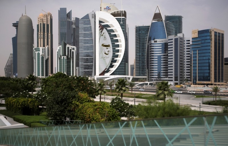 In this May 5, 2018 photo, a giant image of the Emir of Qatar Sheikh Tamim bin Hamad Al Thani, adorns a tower in Doha, Qatar. (AP Photo)
