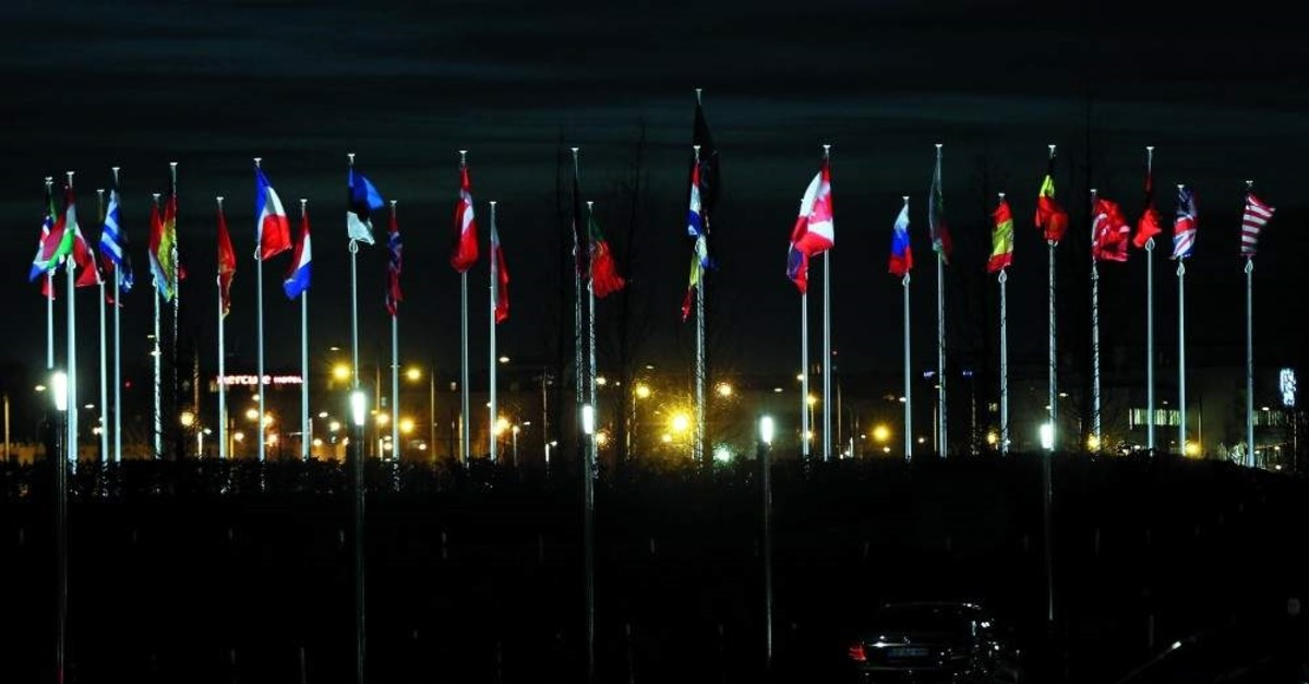 Flags of NATO allies flying at the alliance's headquarters in Brussels, Jan. 7, 2020. (AA Photo)