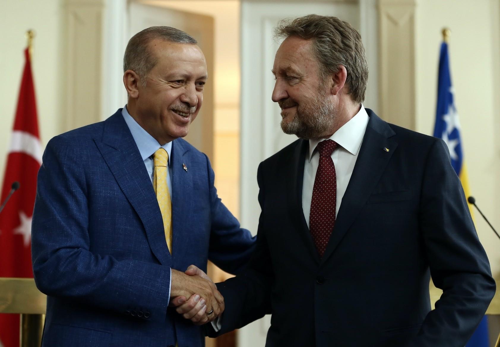 President Erdou011fan (L) shakes hands with Bakir Izetbegovic, the Bosniak member of the tripartite Presidency of Bosnia and Herzegovina, in Sarajevo yesterday.
