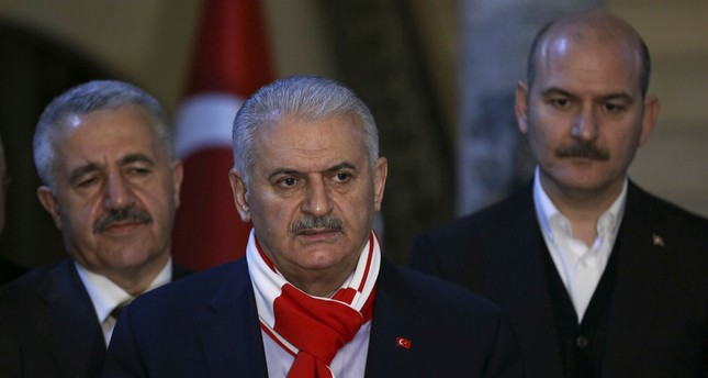 Minister of Transport, Maritime and Communication Ahmet Arslan (L), PM Yıldırım (C) and Interior Minister Süleyman Soylu stand during the Premier's speech in front of Kilis Governor's Office, February 4, 2018 (AA Photo)