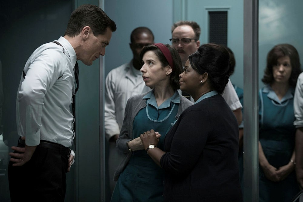 This image released by Fox Searchlight Pictures shows Michael Shannon, from left, Sally Hawkins and Octavia Spencer in a scene from the film, ,The Shape of Water.,  (Fox Searchlight Pictures via AP)