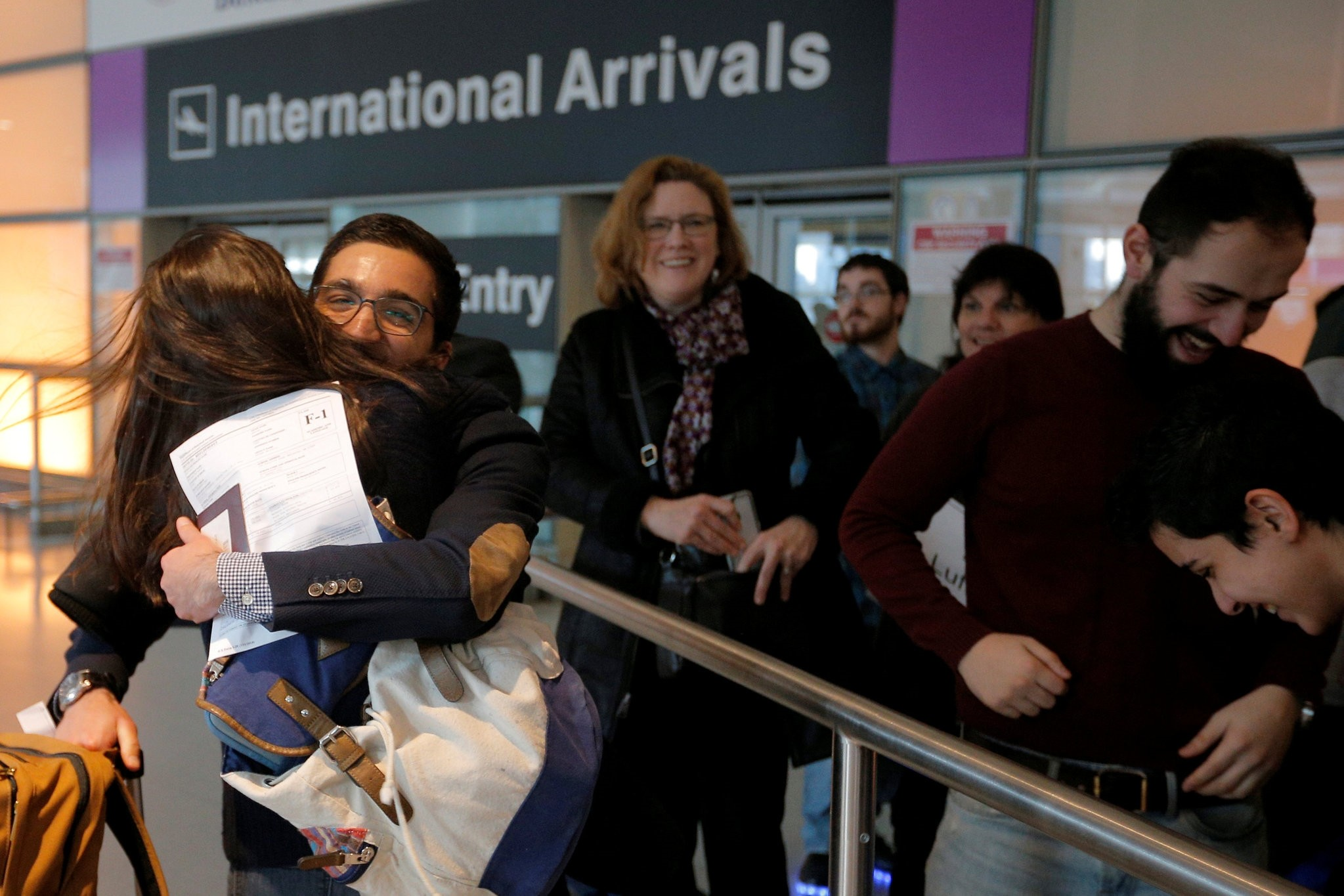 Behnam Partopour, a Worcester Polytechnic Institute (WPI) student from Iran, is greeted by his sister Bahar (L) at Logan Airport. (Reuters Photo)