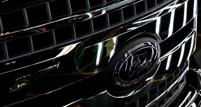 In this file photo taken on September 27, 2018 a Ford logo on a front bumper as Ford 2018 and 2019 F-150 trucks sit on the assembly line at the Ford Motor Company's Rouge Complex  in Dearborn, Michigan (AFP Photo)